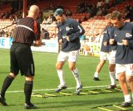 QPR players practice their rapid footwork during a warm-up.