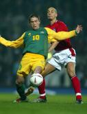 Harry Kewell shields the ball from Rio Ferdinand
